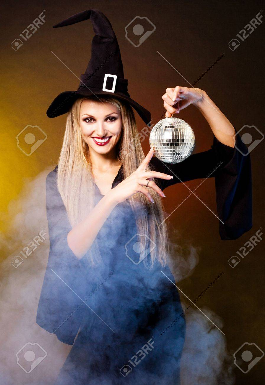 Sexy Young Blond Witch With A Disco Ball, Against Black And Yellow ...
