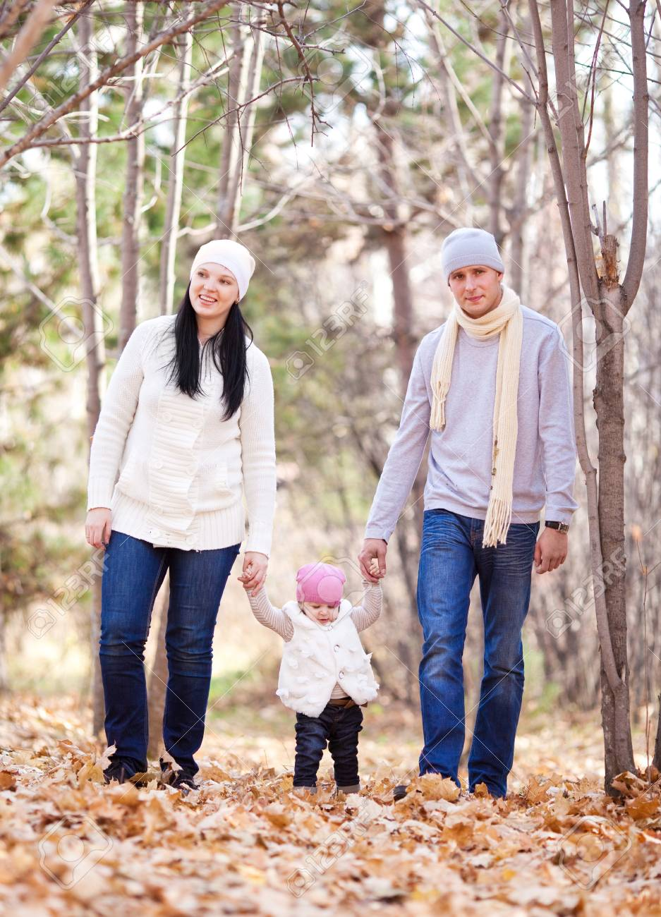 happy young family with their daughter spending time outdoor in the autumn park Stock Photo - 11557229