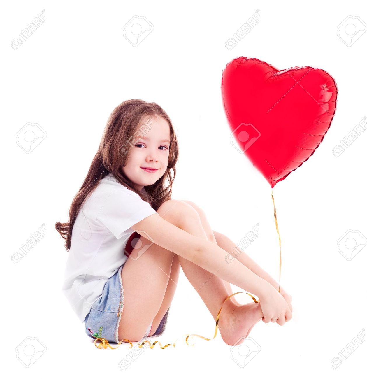 cute six year old girl  with a big red heart-shaped balloon, isolated against white background Stock Photo - 11958662