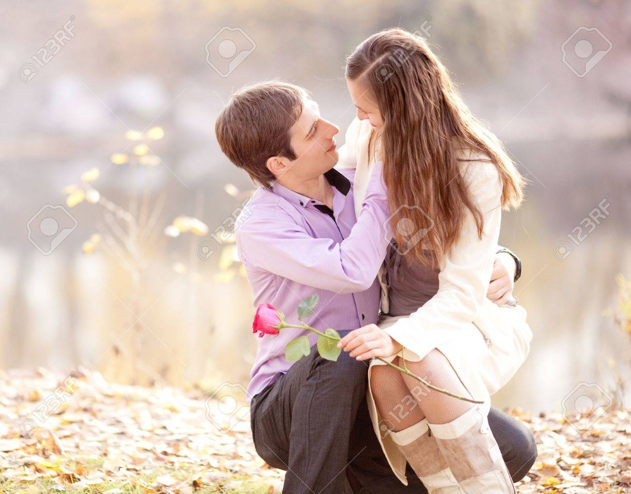 happy young couple spending time outdoor in the autumn park Stock Photo - 12714417