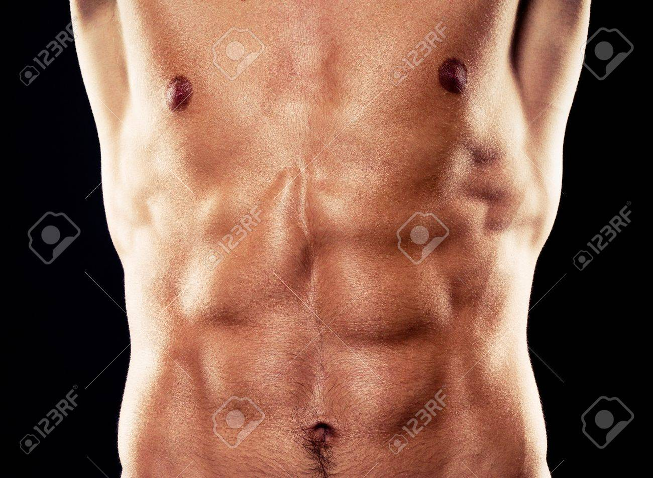 torso of young muscular man, isolated on black background Stock Photo - 12714403