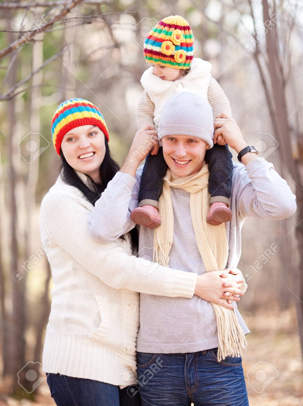 happy young family with their daughter spending time outdoor in the autumn park Stock Photo - 15062813