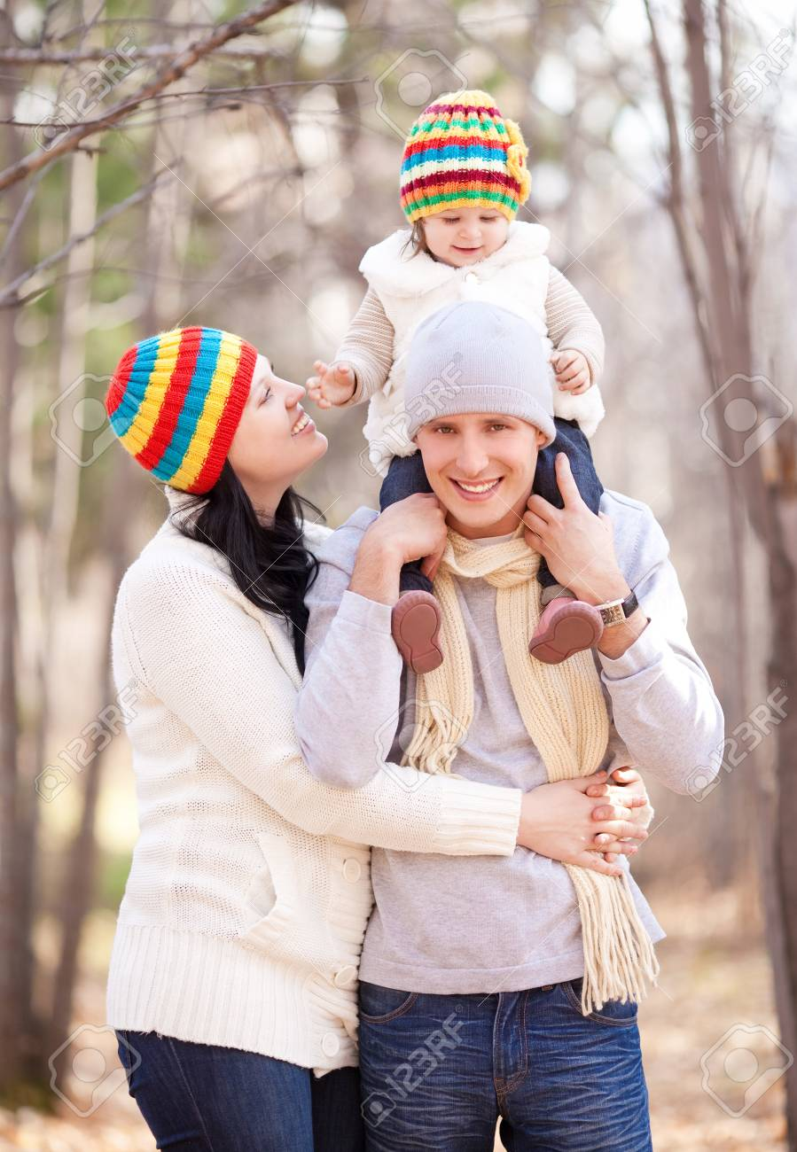 happy young family with their daughter spending time outdoor in the autumn park Stock Photo - 15062814