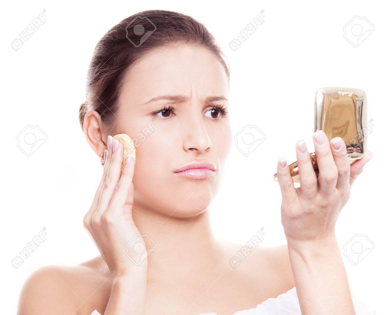 portrait of a displeased woman applying makeup, isolated against white background Stock Photo - 17014991