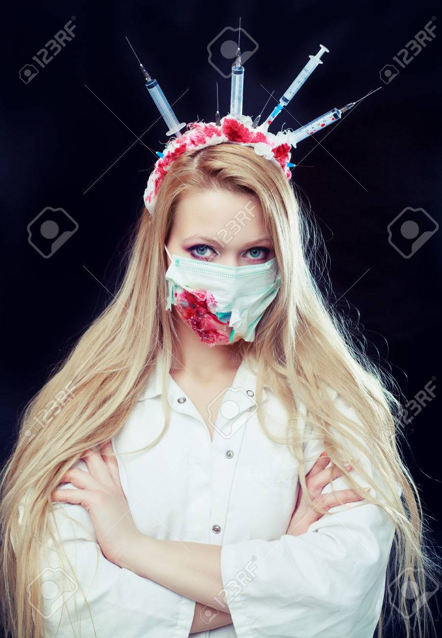 halloween costume of a crazy nurse with crown made of syringes and a syringe in the
