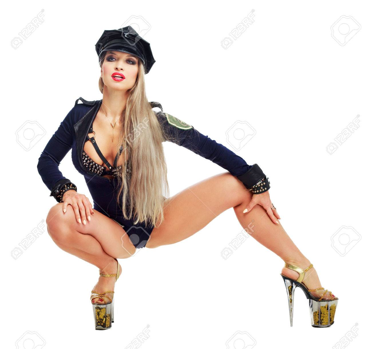 beautiful striptease dancer, dressed as a police officer isolated against  white background Stock Photo -