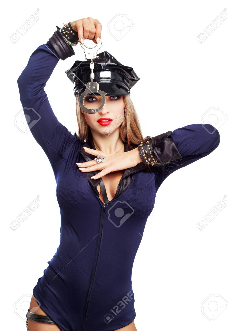 Beautiful Striptease Dancer, Dressed As A Police Officer With Handcuffs  Isolated Against White Background Stock