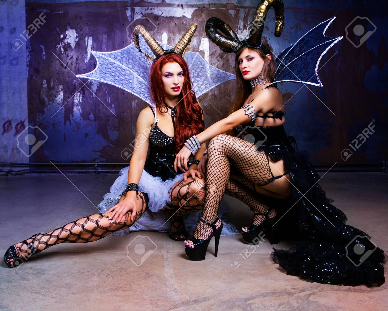 beautiful sexy young models wearing Halloween costume of leather and horns  Stock Photo - 109010046