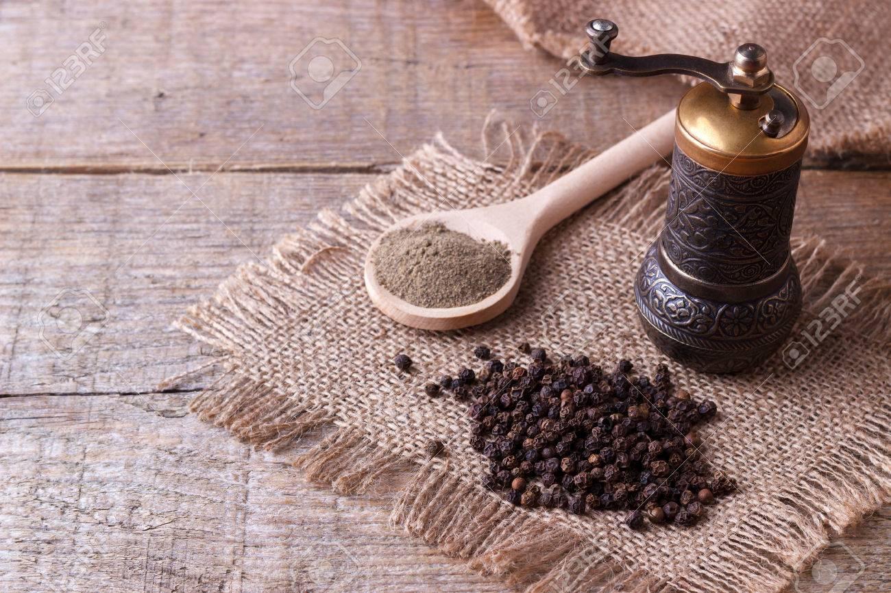 Black pepper corns and Black pepper Powder on wooden background - 57970506