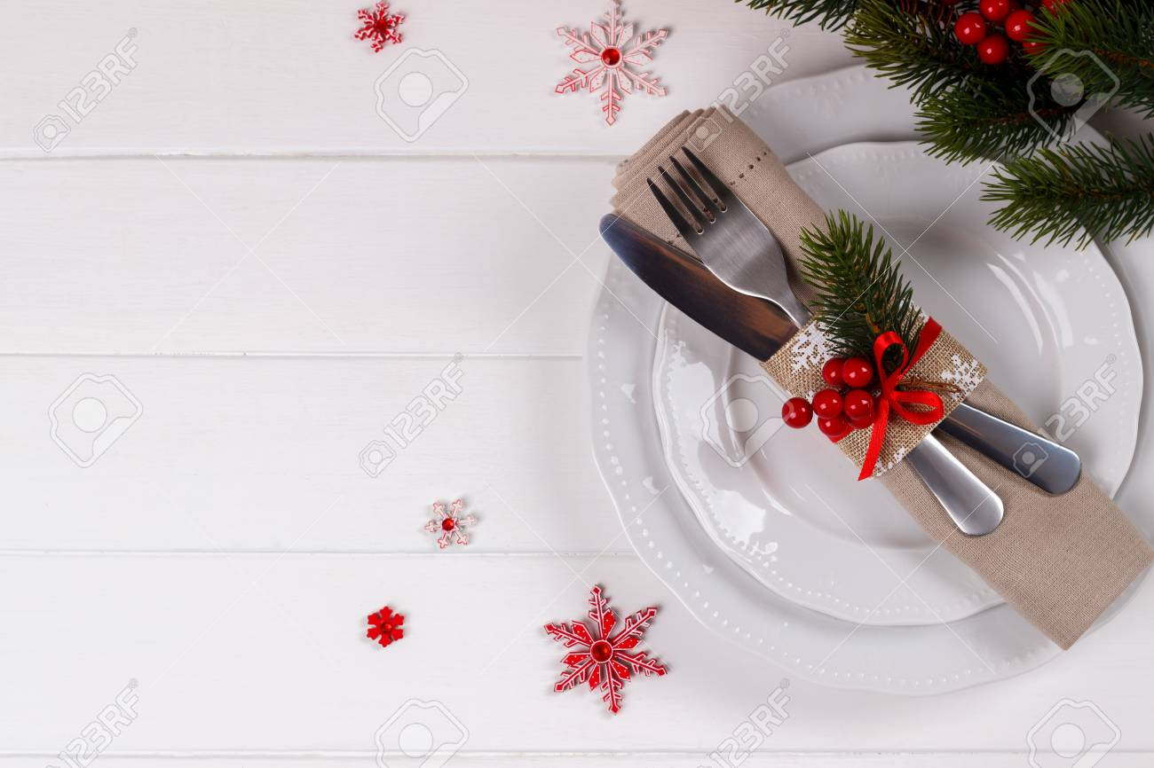 Christmas Table Setting On White Wooden Table. Christmas Card