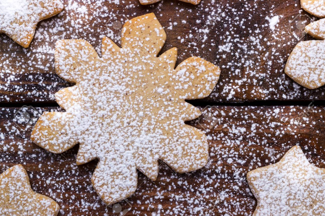 holiday baking background, stars and snow flakes gingerbread