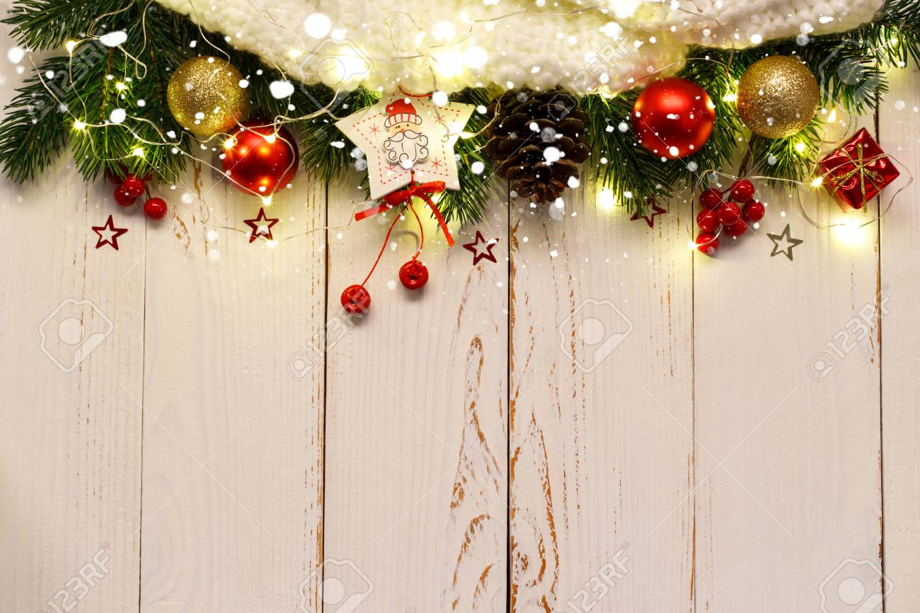 christmas or new year background with festive ornaments and lights on white wooden tablelfat