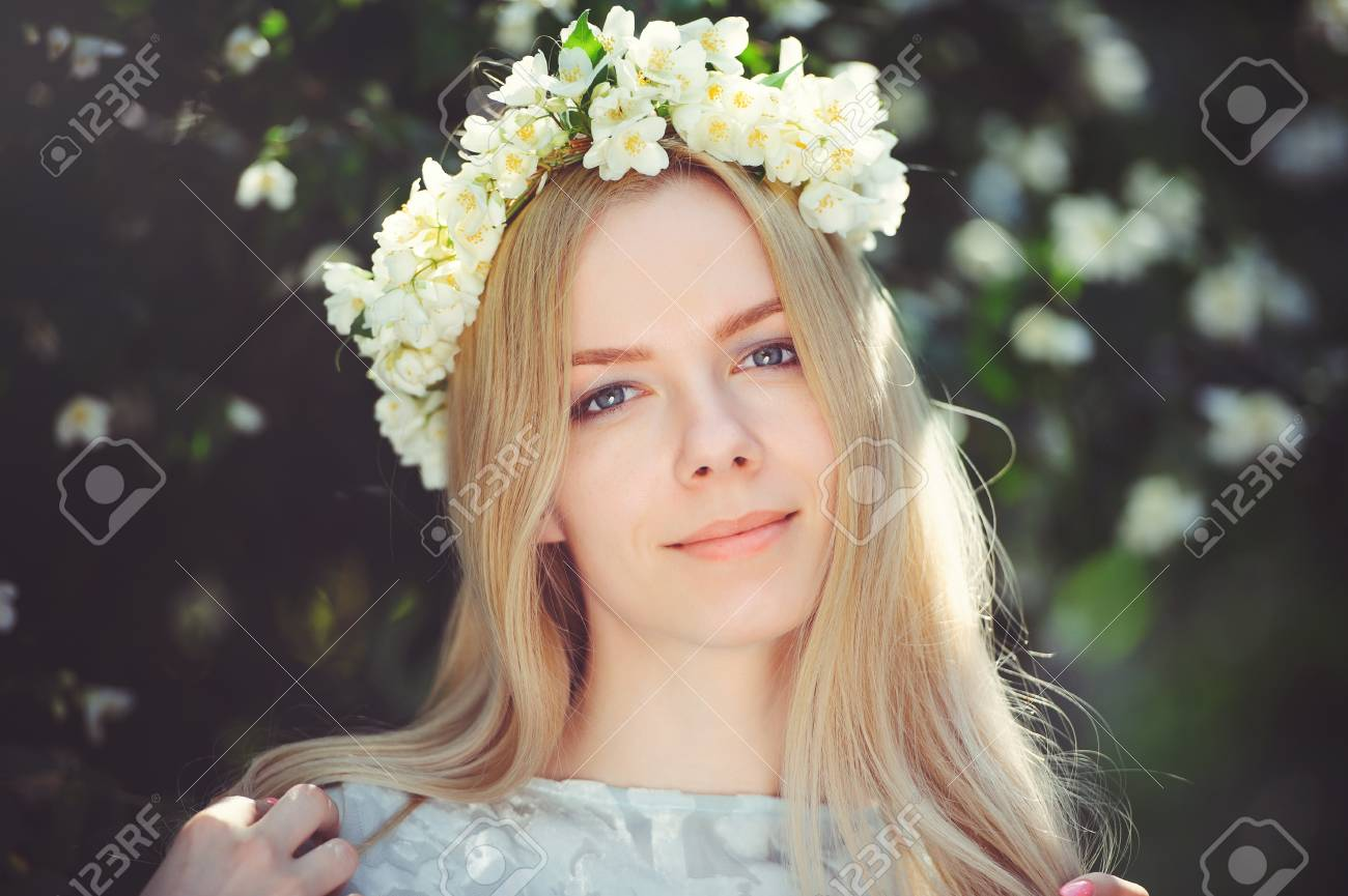 Attractive modest young girl with blonde with jasmine flowers attractive modest young girl with blonde with jasmine flowers wreath on head long hair and natural izmirmasajfo