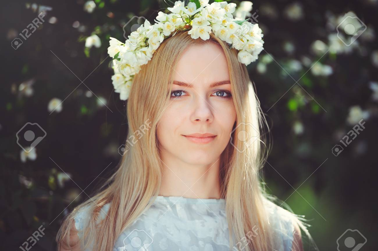 Attractive Modest Young Girl With Blonde With Jasmine Flowers