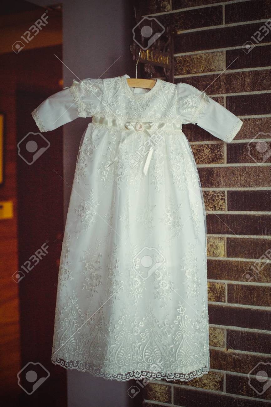 eae39a706 christening baby dress. Close-up of a cute newborn baby dress. Stylish  embroidered