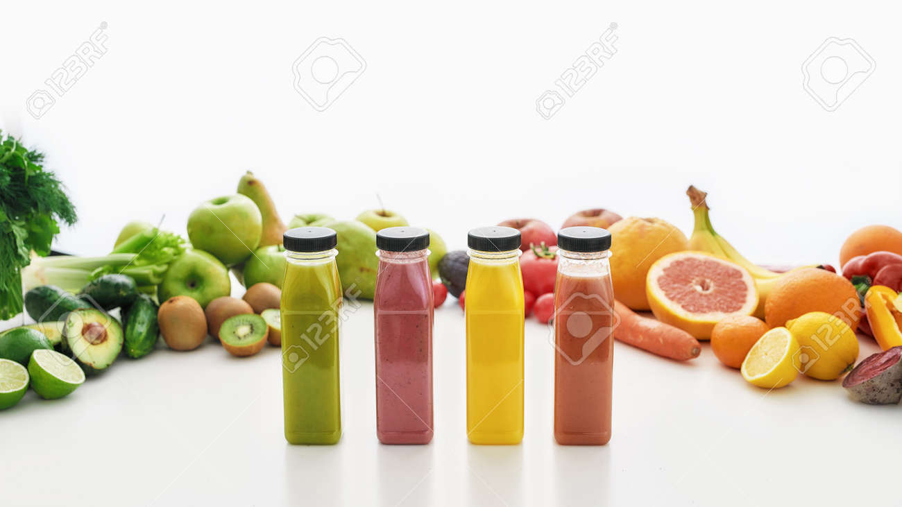 Composition of bottles of healthy detox juices and smoothies with various colorful fruits and vegetables isolated over white background - 156050555