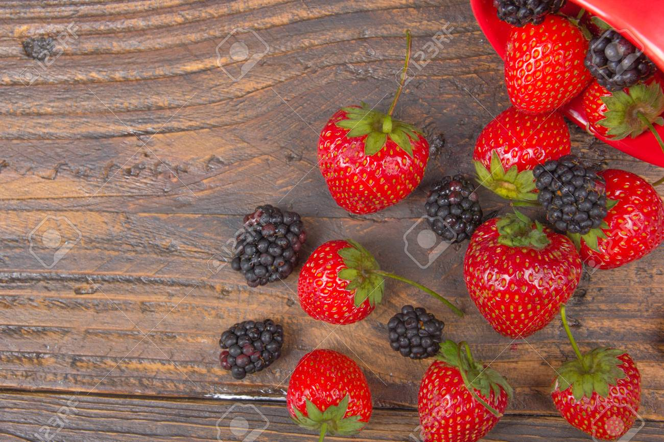 Blackberries Strawberrieson Wooden Table Background Spilled From A Spice Jar Antioxidants Detox