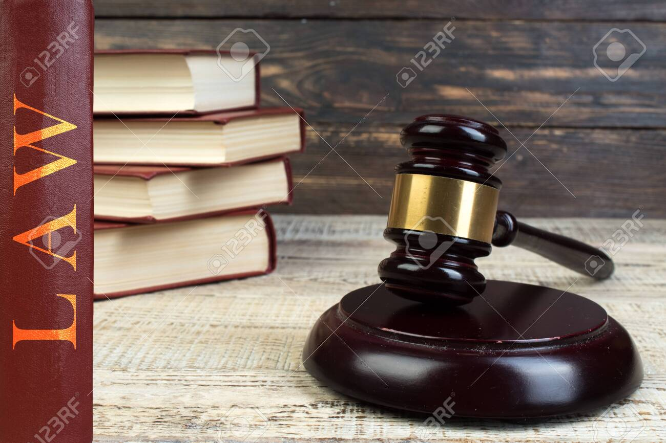 Law and Justice, Legality concept, Judge Gavel on a wooden background, Law library concept. - 124005303