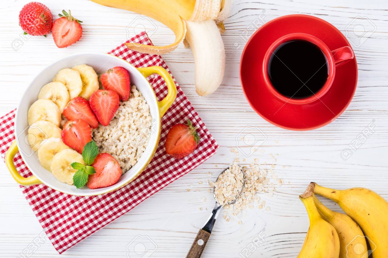 Breakfast Oatmeal Porridge With Fruits Berries And Coffee Cup Stock Photo Picture And Royalty Free Image Image 94731244