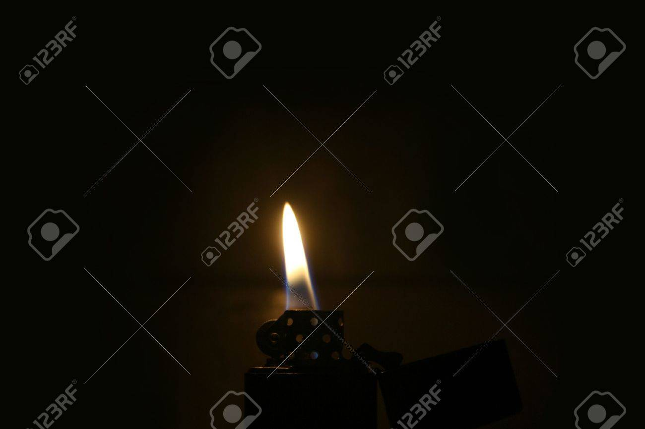 Zippo Lighter With Flame In Dark Room Stock Photo Picture And