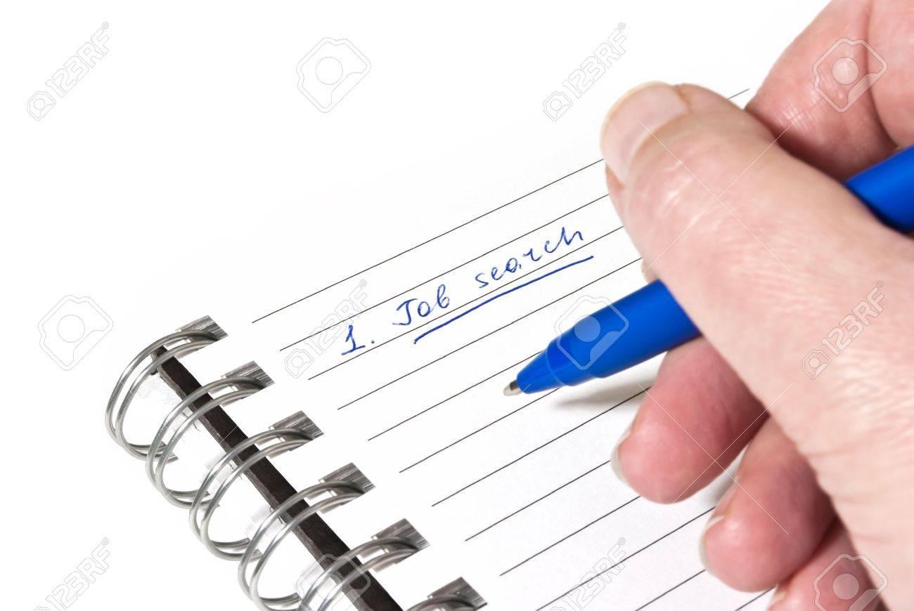writing down a job search plan on white paper stock photo picture stock photo writing down a job search plan on white paper