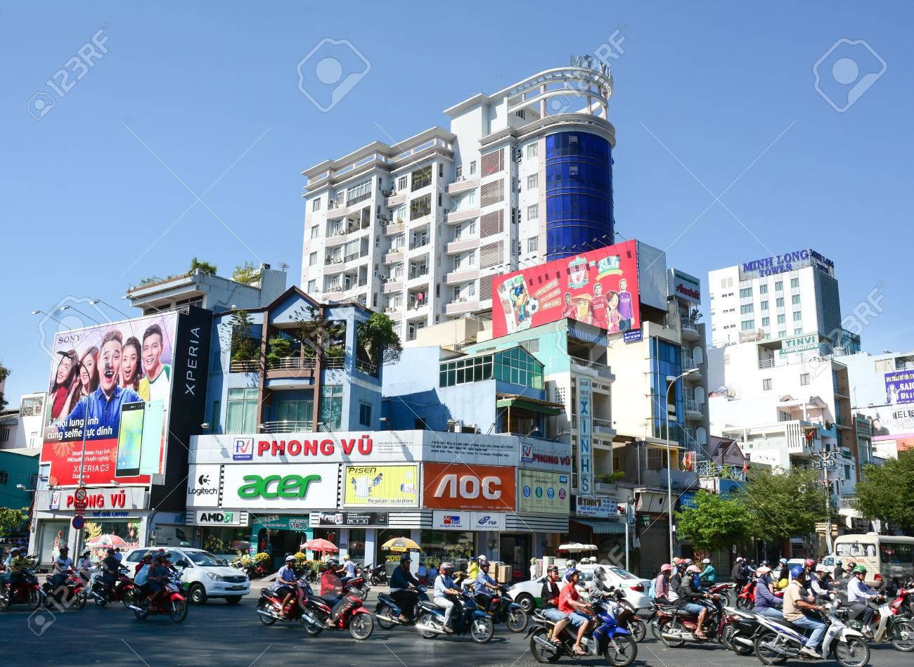 SAIGON, VIETNAM - FEB 26, 2015: Road Traffic in Saigon (Ho Chi Minh City), Vietnam. Ho Chi Minh is the biggest city in Southern of Vietnam. - 38220444