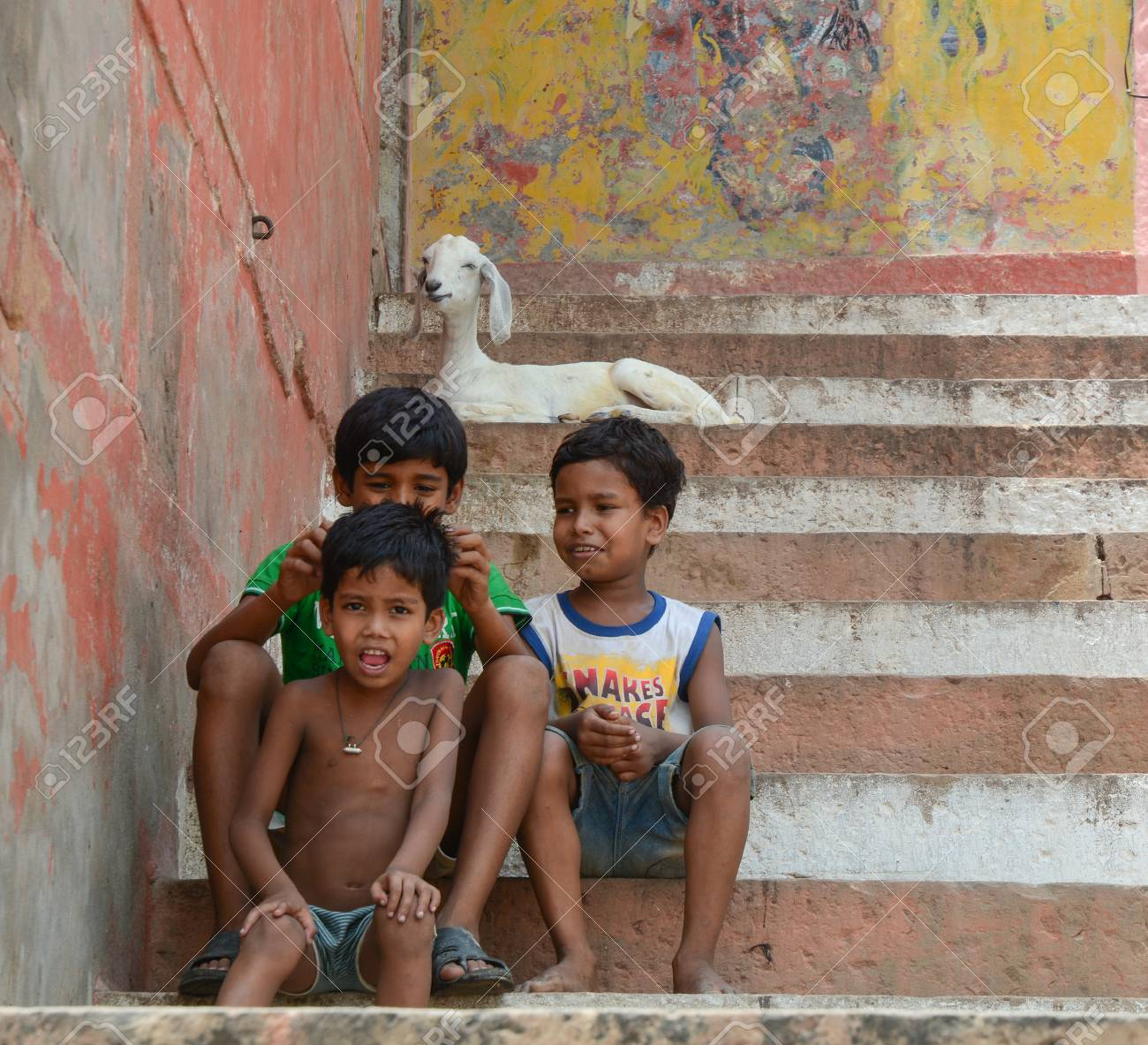 8f07c5de80 Stock Photo - Varanasi, India - Jul 12, 2015. Unidentified young boys in an  Indian village happily sitting on steps and looking at camera, Varanasi,  India.