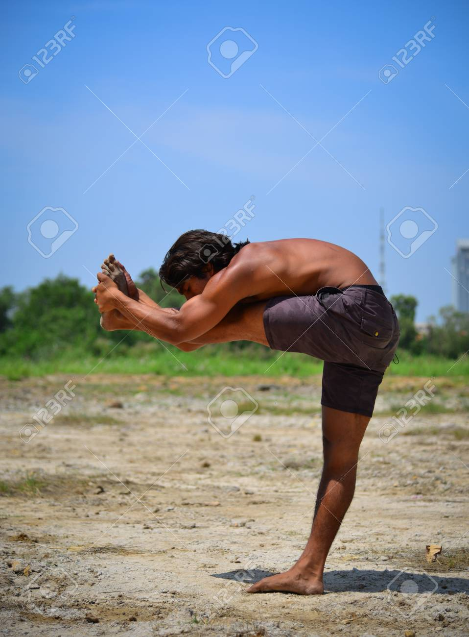 An Indian Muscle Man Doing Yoga Poses At Sunny Day With Cityscape Stock Photo Picture And Royalty Free Image Image 77090640