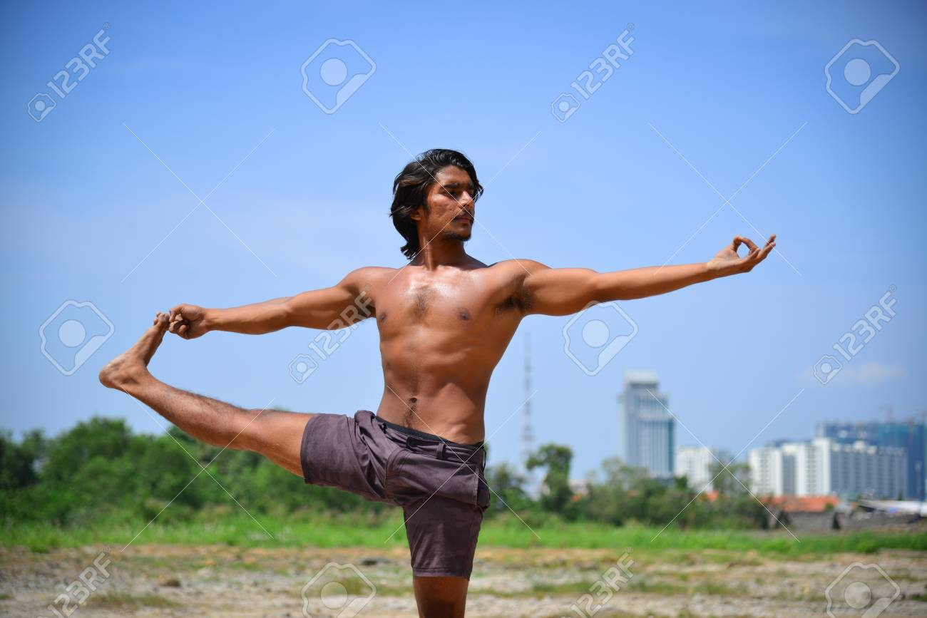An Indian Man Doing Yoga Poses At Sunny Day With Cityscape Background Stock Photo Picture And Royalty Free Image Image 77063383