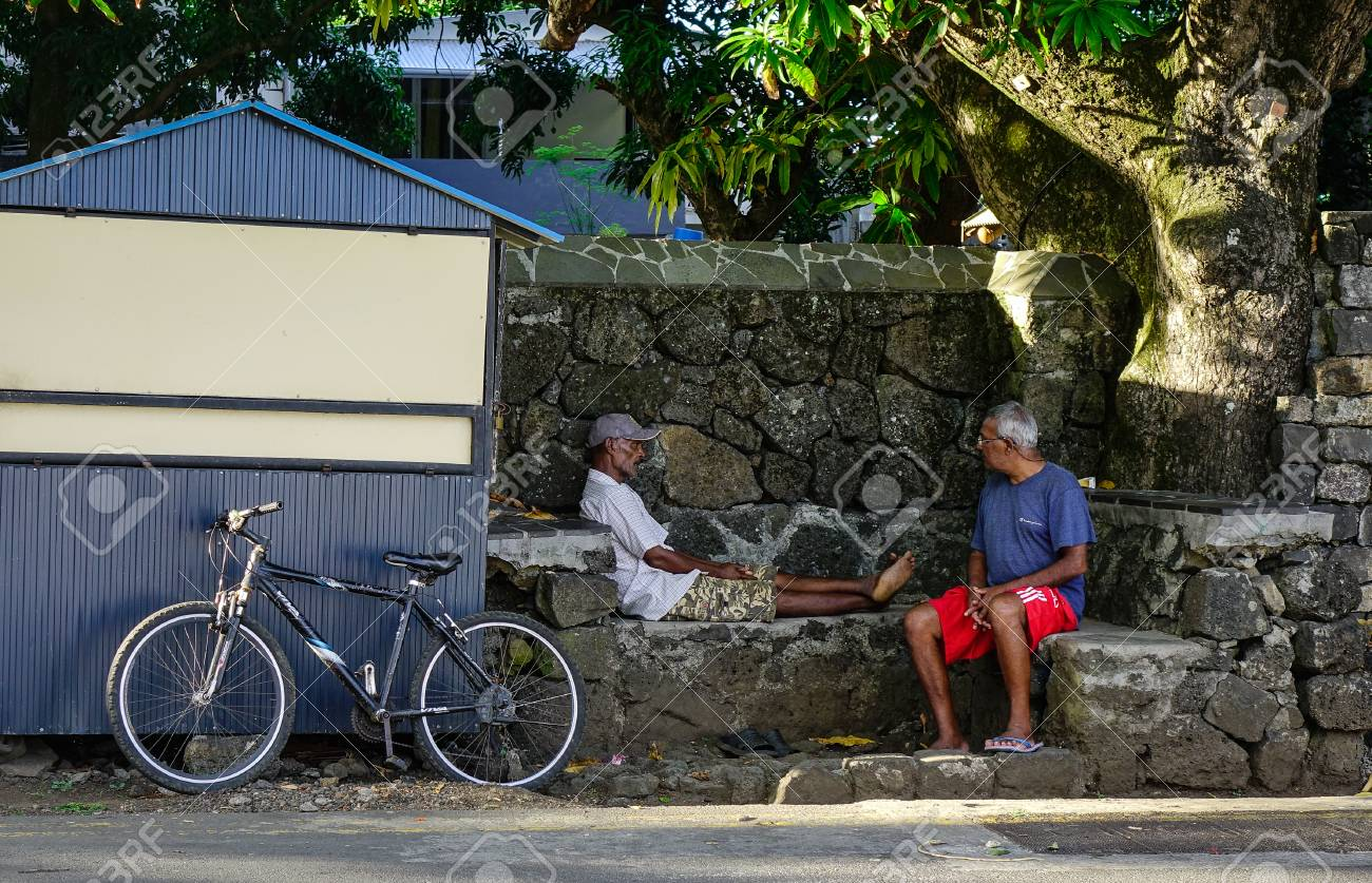 Grand Baie, Mauritius - Jan 11, 2017  Old men sitting on street