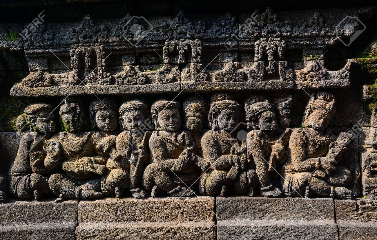 Carved relief under sun light at borobudur on java indonesia