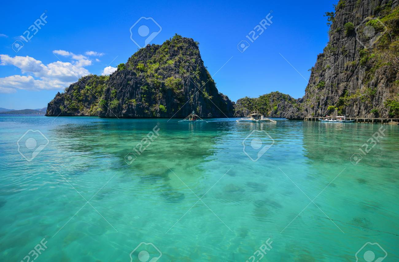 Clear Turquoise Sea Or Lagoon And Speedboats In Coron Islands
