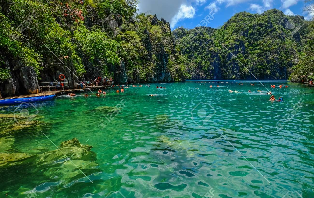 People Enjoy On Kayangan Lake In Coron Island Palawan The Philippines