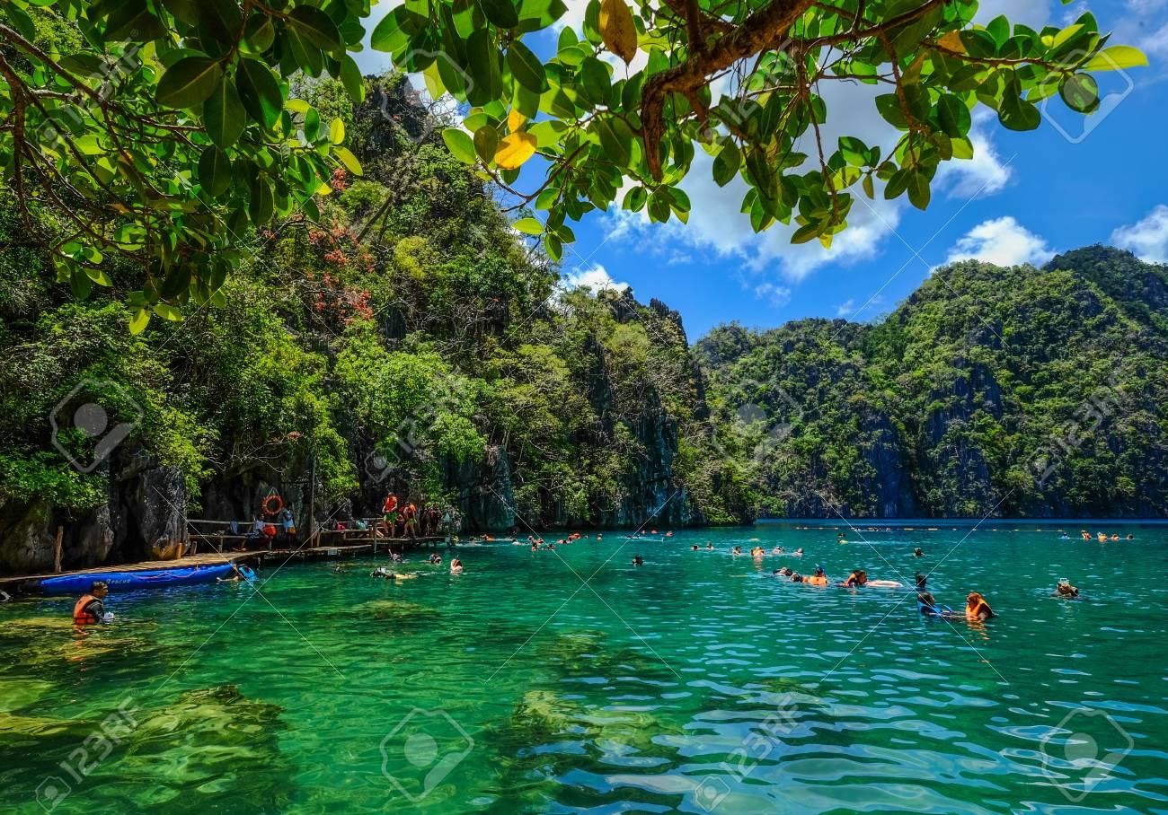 People Swimming On Kayangan Lake In Coron Island Palawan The