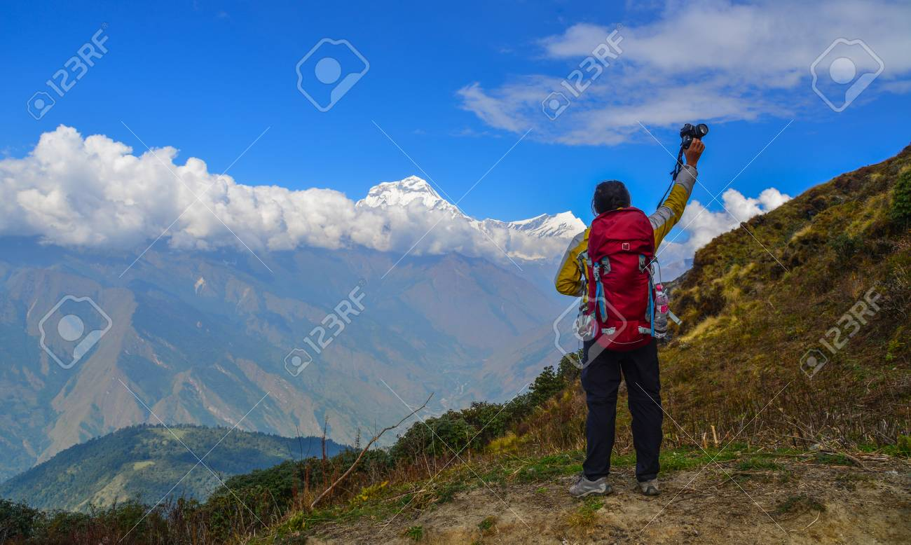A young trekker with backpack standing on the mountain of Annapurna Range 9c9f65066d358