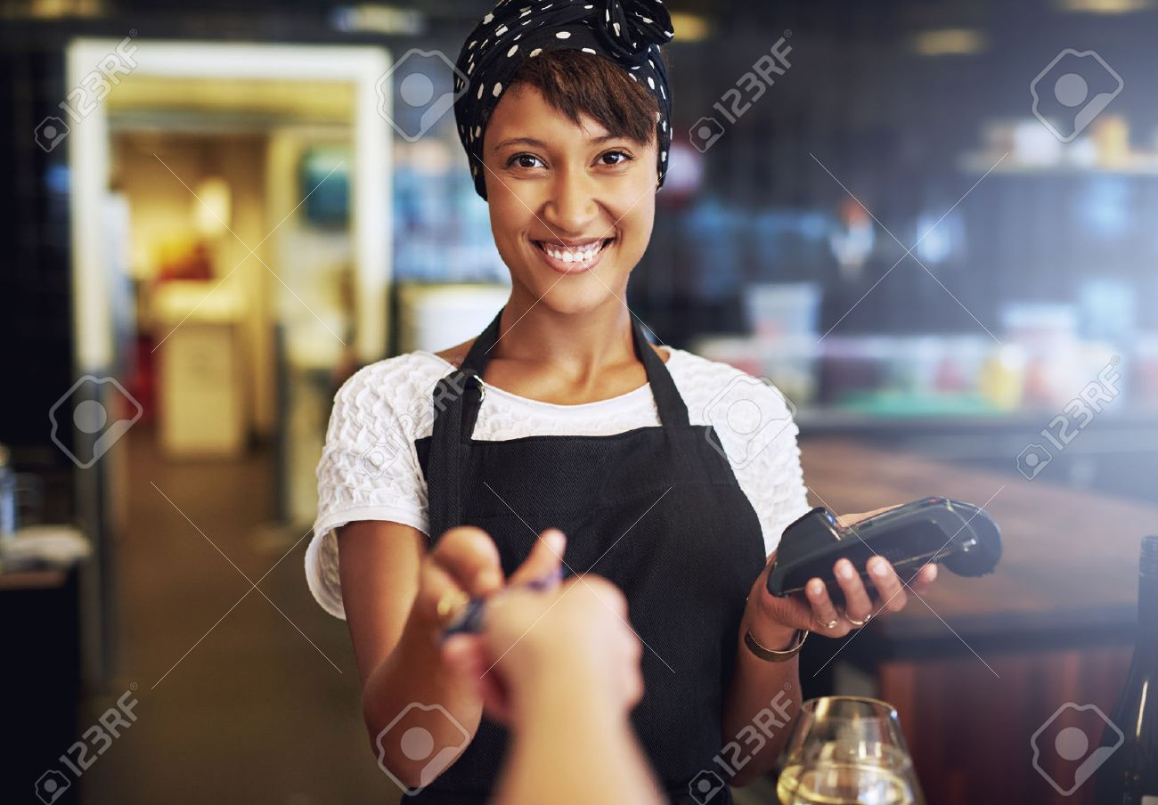 Smiling Waitress Or Small Business Owner Taking A Credit Card ...