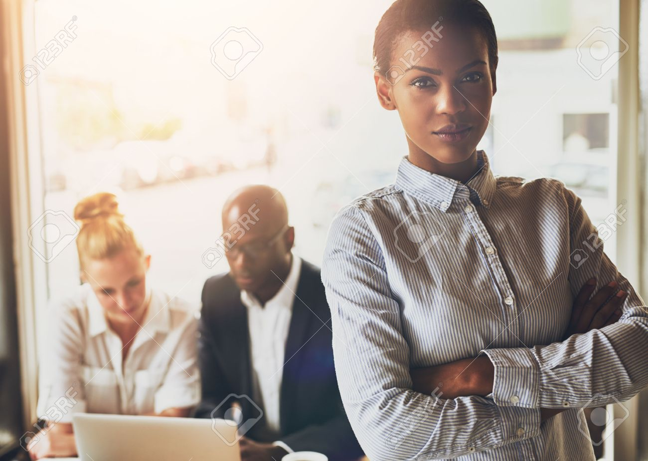 Successful young black business woman standing in front of multi ethnic group of people Stock Photo - 47171009