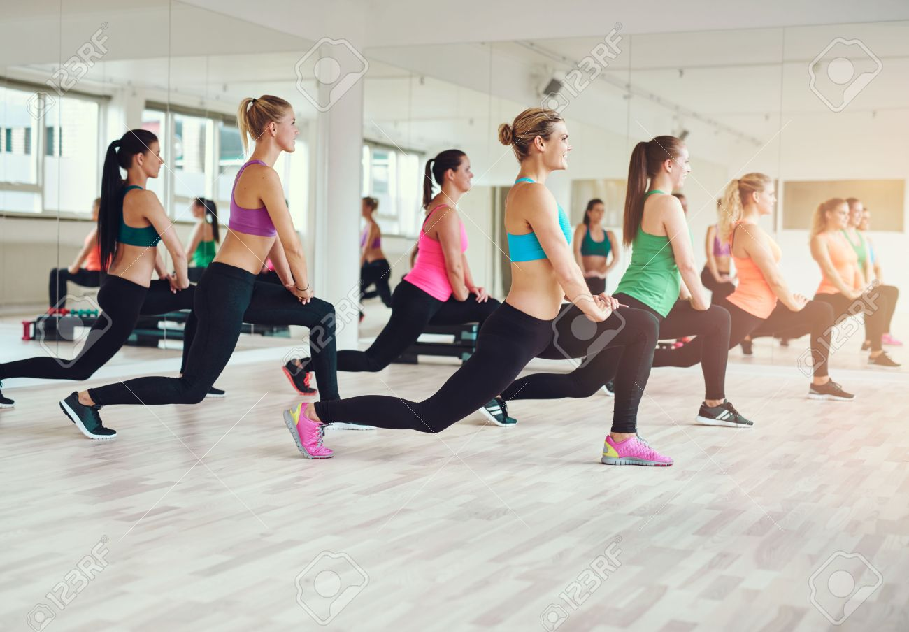 fitness, sport, training, gym and lifestyle concept - group of smiling people exercising in the gym Stock Photo - 47836333