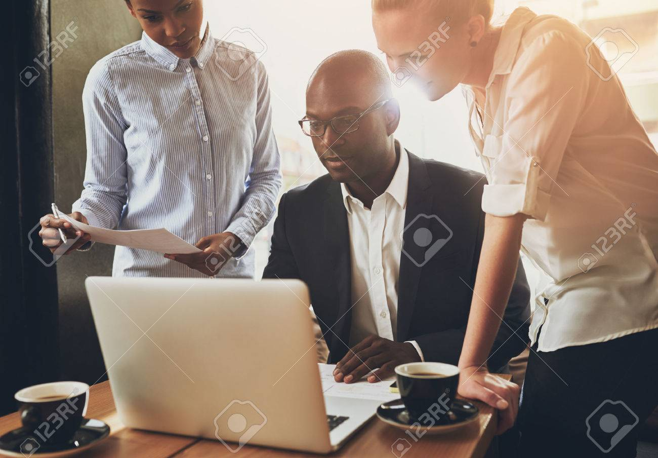 Ethnic business people, entrepreneurs working together using a laptop Stock Photo - 49274095