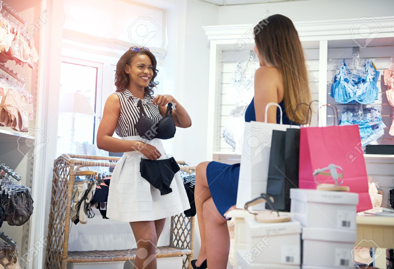Two Happy Chic Young Woman Shopping For Lingerie In A Clothing ...