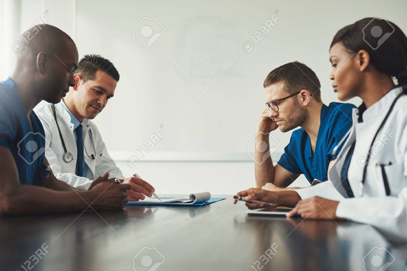 Medical Staff Meeting. Group Of Young People In White Coats And ...