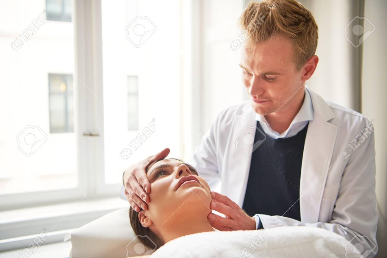 Beauty Specialist Man Holding Head Of Pretty Young Woman Lying Stock Photo Picture And Royalty Free Image Image 93818074
