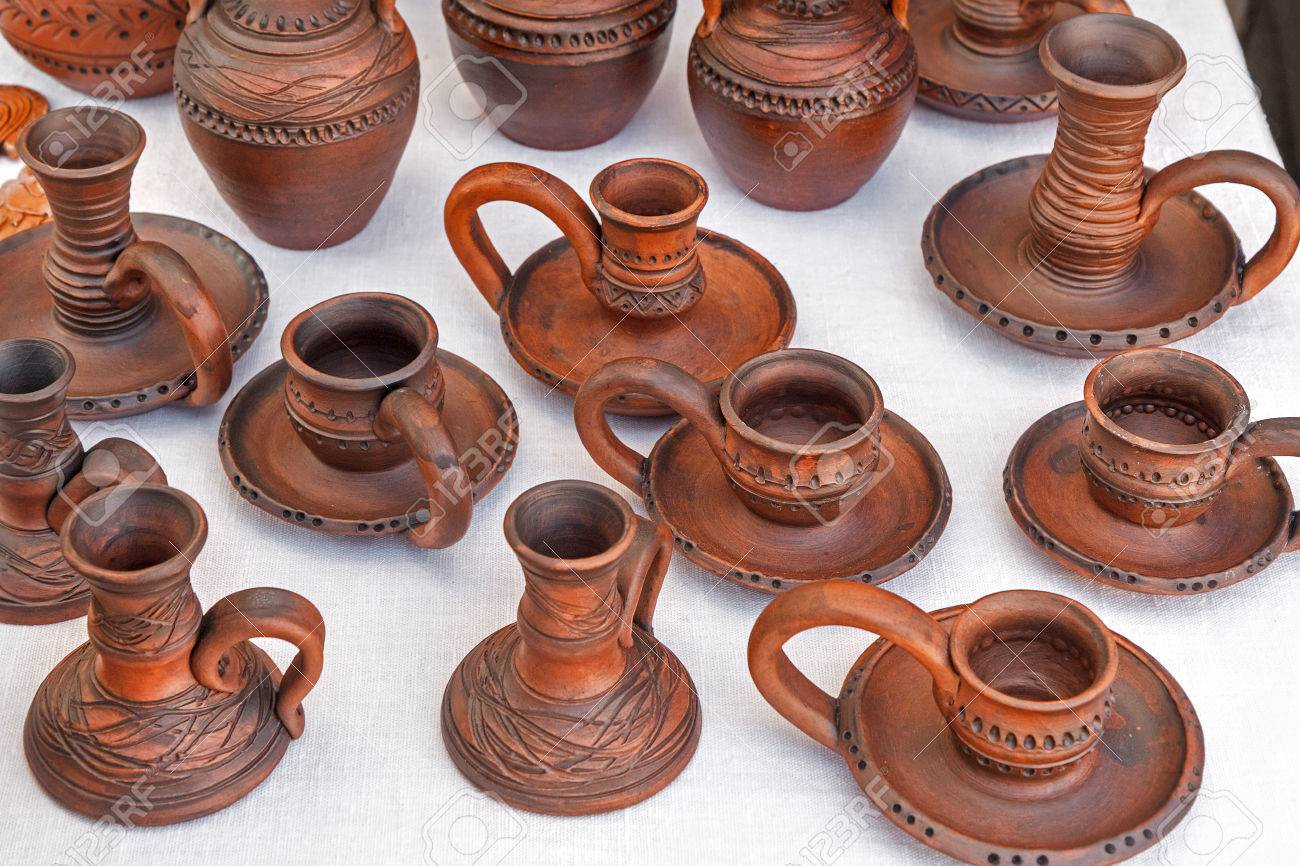 A Variety Of Ceramic Candle Holders Are Represented At A County Fair.  Household Items Made