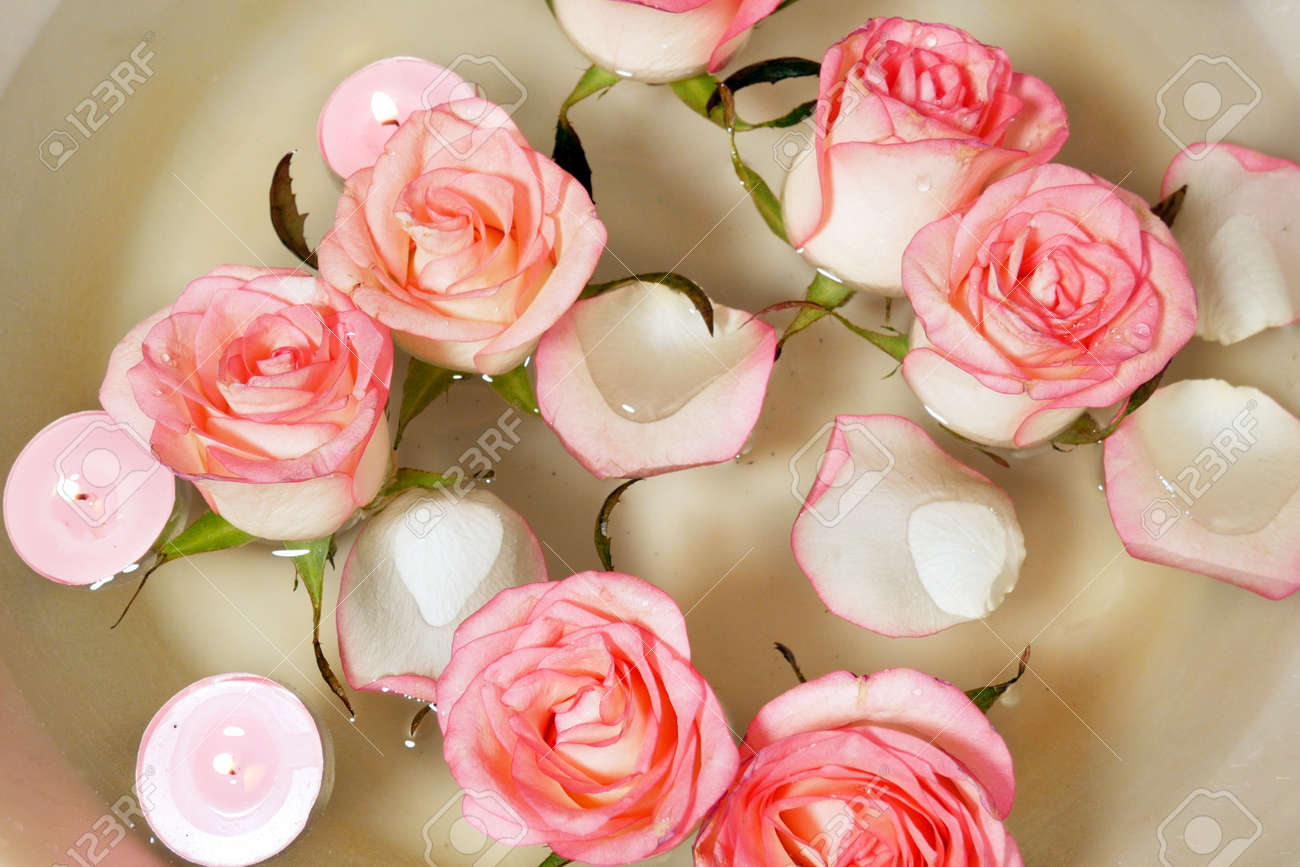 Pink rose, candles and petal floating water in bowl. Relaxing Hand Spa closeup - 157023675