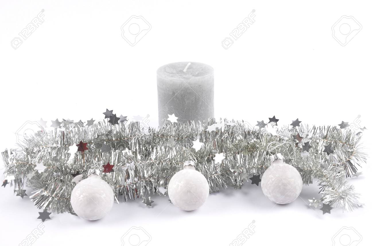 Christmas Garland Candle And Baubles On White