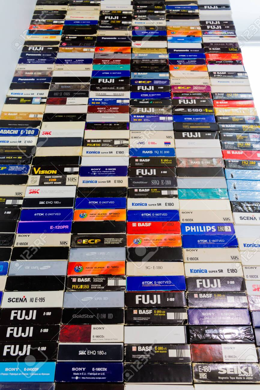 Saratov / Russia - February 15, 2020: A stack of videotapes in VHS format. Colorful boxes of cassettes. - 144729377