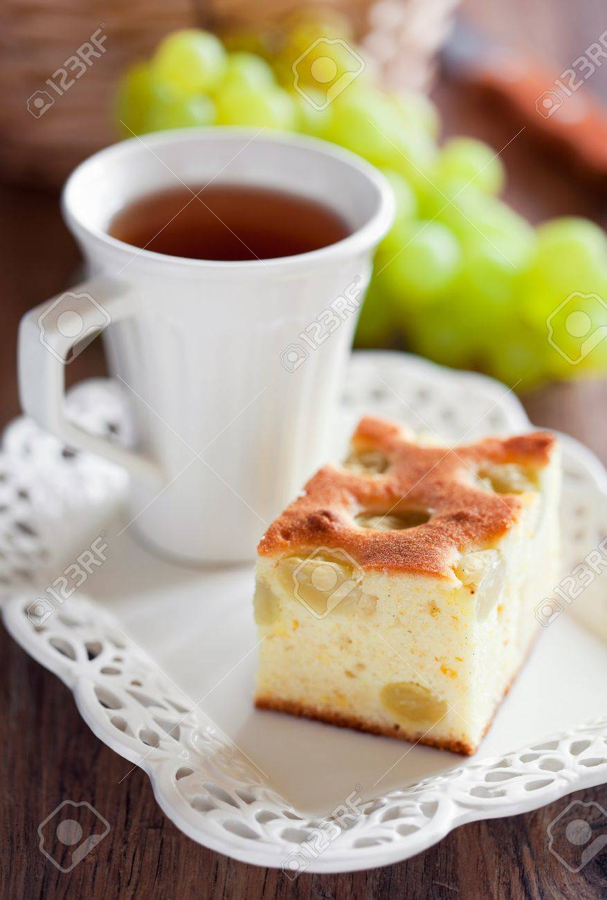 Slice of grape cake and cup of tea. Selective focus Stock Photo - 14609419