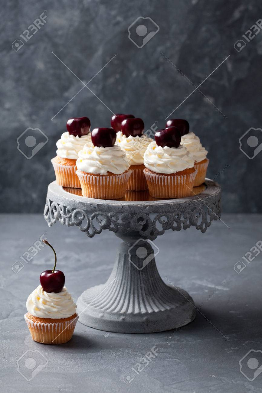 Cherry Cupcakes On A Cake Stand Selective Focus Stock Photo