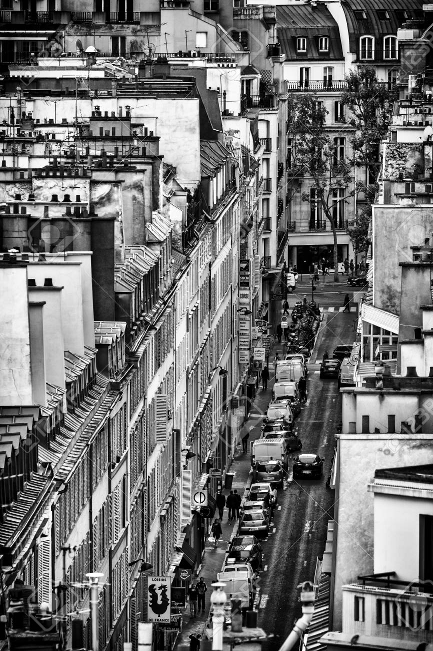 Black and white photo of paris buildings view from the roof streetscene viewed from