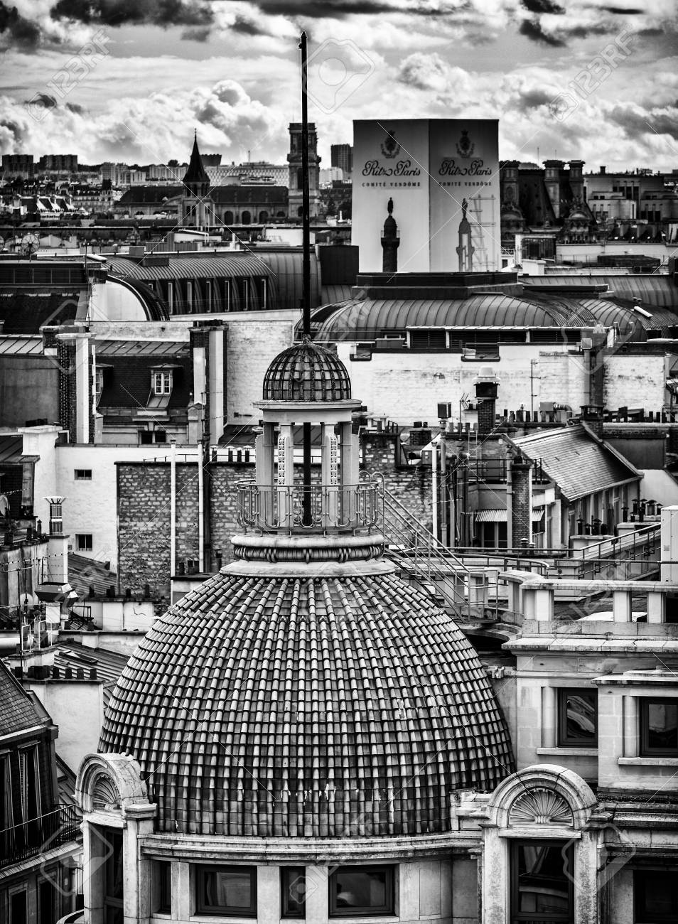Black and white photo of paris buildings beautiful panorama view from famous printemps store in